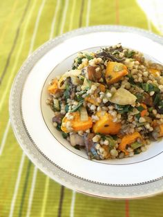 A BuckWheat & Lentil Risotto 450 g pumpkin, diced into 2cm cubes 1 cup buckwheat groats + 2 cups boiling water or very hot stock 3 tbsp olive oil 1 large fennel, diced 1/2 tsp chilli flakes, or to taste 4 garlic cloves, 4 thyme sprigs (use leaves only), or 2 tsp dried thyme zest of 1 lemon 8 (250 g) button or Swiss brown (Portabello) mushrooms, diced 1 cup cooked brown lentils* 4 cups packed (~350g) silver beet greens (Swiss chard), shredded 2 tbsp pitted olives, chopped 1/2 cup thick
