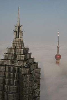 Shanghai's Jinmao Tower and the Oriental Pearl Tower (Shanghai TV) among the foggy clouds in Pudong District.