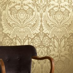 This damask wallpaper represents the height of sophistication as its ornate design will really impose a feel of grandeur on your walls. The gold-on-gold colour scheme is particularly bold and bright, and matches with the more subtle furnishings. Three other choices are also available in this design, introducing different colour schemes to similarly ornate patterns, including a rather powerful pink piece.