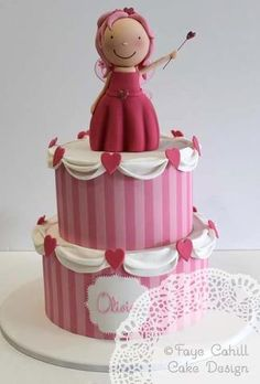 Pink stripped two tier princess cake by Faye Cahill Cakes. Like the narrow vertical stripes, would look nice with flowers on the bunting.