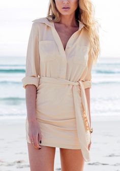 Model wearing beige mini shirt dress