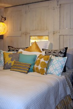 homemade pillows teal grey and yellow --plus that red and grey pillow over there >