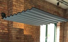 Grey felt acoustic ceiling canopy in office