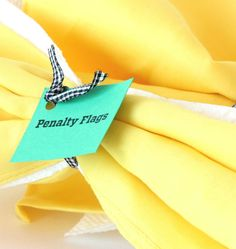 Toss these game day DIY penalty flag napkins on the table to add festive fun to any football bash. Use ribbon to match your team's colors for extra flair. - Everyday Dishes & DIY