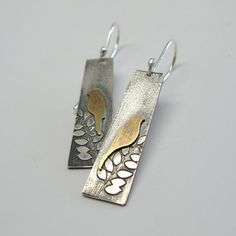 Two brass birds sit perched on leafy branches. Patina finish. French ear wires. 1 1/4 length not including ear wire length. With ear wires it is approx. 1 -1/2-1 3/4. Made to order. Made using reclaimed sterling silver (not mined), as most of my work is. There may be slight
