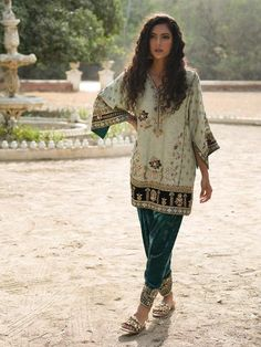 NIMR KURTI & SKINNY SHALWAR The Nimr kurti exudes festive and timeless elegance. It is inspired by the bohemian nomad in a mix of Persian and Central Asian and the finest quality needlecraft to create Pakistani Couture, Pakistani Bridal Dresses, Pakistani Outfits, Indian Dresses, Indian Outfits, Kurti Pakistani, Bridal Lehenga, Indian Attire, Indian Wear