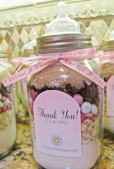 """Been looking for a photo of this for baby shower -- Great idea minus the nipple top (just too weird).  Use mason jars --- pink M's for Baby Girl / Blue M's for Baby Boy / Yellow, Green, White, Etc. if unsure.  Eliminate front label & tie 2x3"""" card stock w/recipe around lid with ribbon (punch hole in card).  Could also cover lid w/fabric square in various colors to tie in w/shower theme."""