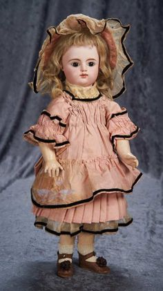 French Bisque Bebe by Gaultier Freres ~~~ Marks: F.G. (scroll) 6. Comments: Gaultier Freres, circa 1888. Value Points: pretty bebe has original body and body finish, wears antique costume.