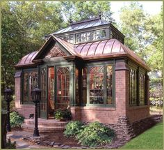 Brick conservatory/orangery. Curved copper roof, gabled entry.