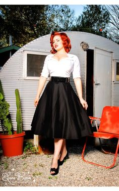 Doris Skirt in Black Sateen Our love affair with the Doris skirt continues! This gorgeous full skirt is pure vintage style in a luxe cotton sateen, with a wide vinyl belt to define your waist and a flattering full swing cut. - See more at: http://www.pinupgirlclothing.com/doris-skirt-black.html#sthash.OolVnBdH.dpuf