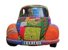 This adorable vintage VW Bug is completely upholstered in a patchwork of bohemian fabric.
