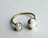 this kind of ring i could squeeze together and it might actually fit me. Etsy-Bronze Dual Stone Ring-Opal and Opal