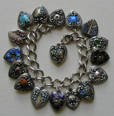 A collection of the larger vintage hearts both enameled and stoned.