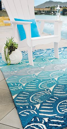 You can almost hear the sound of waves lapping the shore with our Sanibel Outdoor Rug.