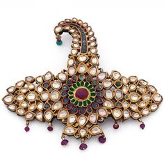 A ruby, emerald, diamond and 18K gold Indian turban ornament. 12 x 10 cm