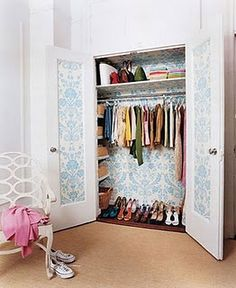 wallpapered closet- great idea for small closet