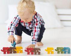 He encontrado este interesante anuncio de Etsy en https://www.etsy.com/es/listing/238425944/rompecabezas-de-elefantes-de-madera-con