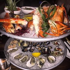 Tower time  #seafoodtower #rawbar #mussels #clams #oysters #lobster #crablegs #getinmybelly #catchnyc #EMMEATS