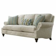 """Nailhead-trimmed sofa with a tufted apron, 2 throw pillows, and a kidney pillow. Made in the USA. Product: SofaConstruction Material: Wood and fabricColor: Natural and greenFeatures:   Made in the USANailhead trimIncludes two throw pillows and one kidney pillow  Dimensions: 37.5"""" H x 88"""" W x 40"""" D"""