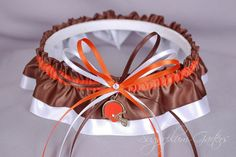 b61dcaa83ab A Cleveland Browns inspired wedding garter belt in orange and brown satin  overlaying white satin