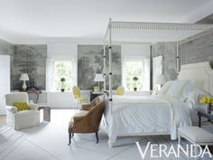 White/grey bedroom with yellow accents in the chairs and flowers - the walls are done in a greyscale mural and the bed is traditional and luxurious. The yellow hints also appear in the bedsheets. Bonnie Williams, Delaware
