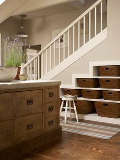 More 'under the stairs' storage in baskets.