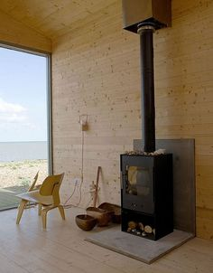 wood wall and floor, modern fireplace, living room design ideas Tiny Beach House, House, Small House, Home, Hearth Pad, Beach House Pictures, Beach Cottage Decor, Wood Stove Hearth, Wood Stove