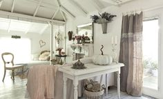 I love this romantic prairie style bedroom. I've always had a soft spot for white wood