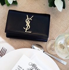 LOUISA nextstopfw | black white outfit fashion streetstyle minimal classic chic ysl bag silver handbag
