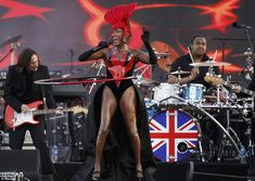 As unusual as ever: Grace Jones didn't disappoint with her outfit and took to the stage in a black and red outfit and she was seen hula-hooping as she sang
