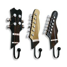 "Guitar Hooks (Set of 3)    Decorative and functional, these rockin' hooks are perfect for anywhere in your house, apartment or dorm room. Crafted of resin with beautiful guitar detailing, these hooks are sturdy, stylish and easy to hang. It's perfect for the music lover in your life. Each hook measures approximately 3"" W x 7 1/2"" L.- This would be neat for Tom's ""Man Cave"" ... when we get a house!"