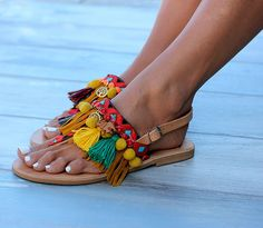"Handmade sandals made of genuine leather. Very comfy and steady, consisting of two leather straps on the front of the foot and one more in the back. We sew the straps by hand with fringes, fabric and metallic trims and pom poms. ""Afrika"" are embellished with gold plated charms that[...]"