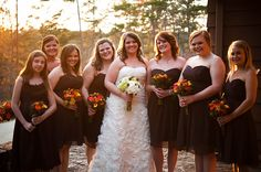 Bridesmaids : chocolate dresses with autumn colored bouquets