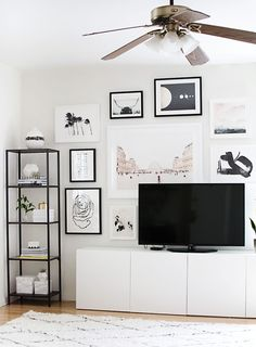 A minimalistic black and white gallery wall behind the television spruces up that once-empty white space.