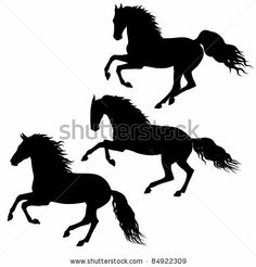 Three black running horses silhouettes isolated on white background by IronFlame, via Shutterstock