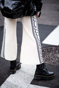 Street style from New York fashion week included these platform Doc Martens with wide leg white pants