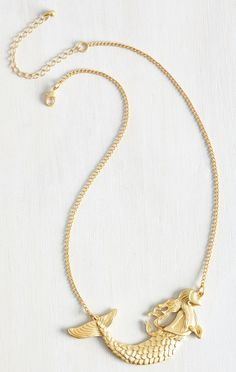 A gorgeous gold mermaid necklace.