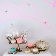 "Pin for Later: 18 Times Real Girls Nailed Glamorous Halloween Decor Pastel pink cobwebs, mercury glass pumpkins; all we can say about this whimsical vignette is ""wow. Halloween Rose, Halloween Chic, Adult Halloween Party, Halloween Home Decor, Halloween Birthday, Holidays Halloween, Halloween Crafts, Halloween Decorations, Modern Halloween"