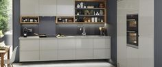 Subtle, stylish and versatile, grey kitchens are the new neutral of choice. Find ideas and inspiration in this list of our favourite grey kitchen designs. Grey Gloss Kitchen, Gloss Kitchen Cabinets, Kitchen Cabinet Doors, Cupboards, Howdens Kitchens, Grey Kitchens, Home Kitchens, Fitted Kitchens, Buy Kitchen