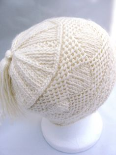 Twined knitting effect in one colour.