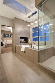 OMG love the glass fireplace right in front of the tub and you can see it from the room and the bathroom.