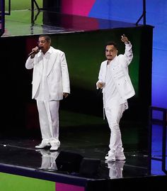 Singers Zeca Pagodinho, left, and Marcelo D2, right, perform during the opening ceremony for the 2016 Summer Olympics in Rio de Janeiro, Brazil, Friday, Aug. 5, 2016.