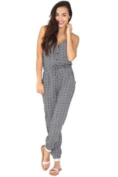 Navy and white printed jumpsuit featuring front button closure, drawstring waistband, dual side pockets, adjustable straps and gathering at the ankle that can be wrong hiked up or down. The perfect travel piece! Pair with big sunniest and your comfiest sandals.