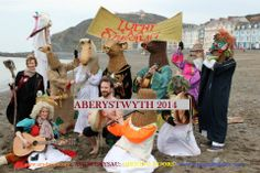 """Parade finished on Aberystwyth beach for 25th International Welsh Theatre Festival """"Agor Drysau: Opening Doors"""" hosted by Arad Goch Theatre, Aberystwyth"""