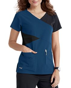 The Grey's Anatomy Signature mock wrap scrub top has detailed style lines and roomy pockets. Shop now! Greys Anatomy Scrubs, Scrub Tops, Shop Now, Pocket, Suits, Phlebotomy, Grey's Anatomy, Caregiver, Color