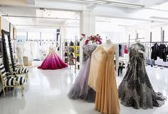 Love coming into a clean and pretty showroom on Mondays with beautiful gowns on display!  Chris Goodney.