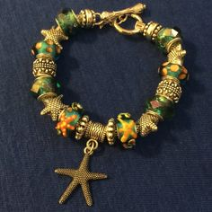 """Handmade Starfish charm bracelet. Handmade (by me) Starfish silver-tone charm bracelet. 20cm/7.9"""". Materials include: zinc metal alloy, copper, glass. Get the designer look for the cost of one brand name bead! All offers considered  Jewelry Bracelets"""