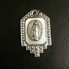 Vintage Sterling silver Virgin Mary This is a very very old Vintage Sterling silver with mother of pearl  Blessed Virgin Mary Mother of God Italian Medal of the Immaculate  Conception. Jewelry Necklaces