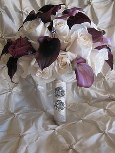 Almost exactly like this??? Except white roses and silver wrapped stems??   Ivory roses and plum calla lily bouquet