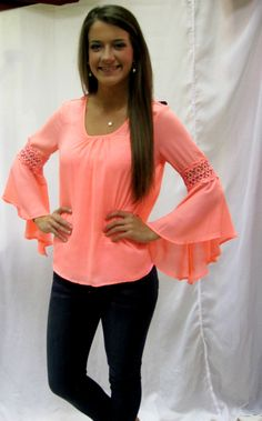 Follow your inner poetic in this vintage flared neon coral blouse!
